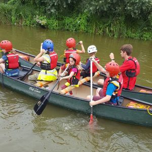 Children canooing in Savernake Avenue Holiday Club