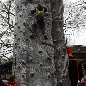 Children on climbing wall in Savernake Avenue Holiday Club