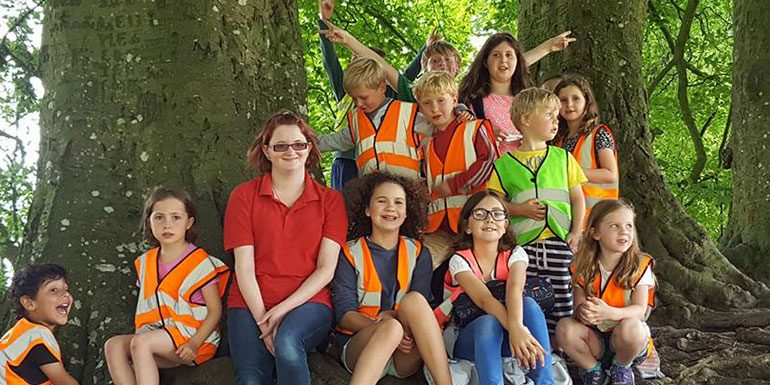 Children and staff in Savernake Forest in Avenue Holiday Club