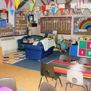 Sofa area and tables ready to play in the after school and holiday club