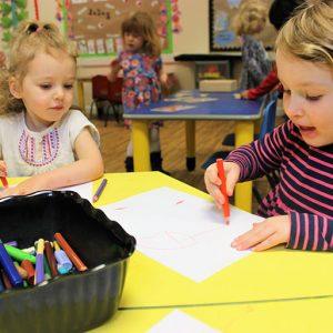Children drawing in Big Acorns room Andover