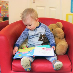 Child reading a book in Buttercups room Andover