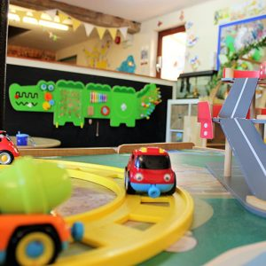 Toy cars on track in Buttercups room Savernake