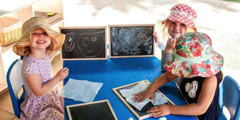 Children playing with blackboards in garden in Andover nursery