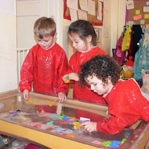 Children enjoying water play in Marlborough nursery