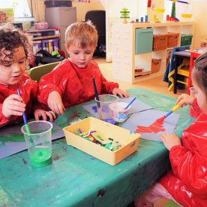 Children enjoying painting pictures in Marlborough nursery
