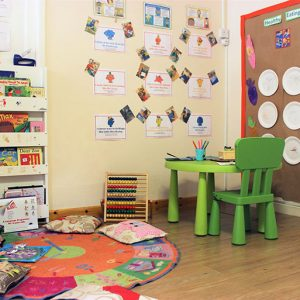 Book and table corner ready for children to play in Marlborough nursery