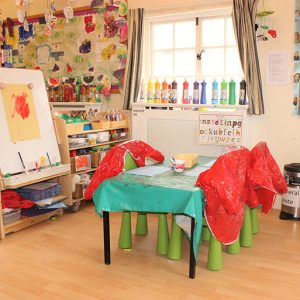 Paint table and easel ready to play with in Marlborough nursery